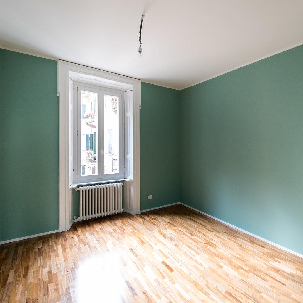 """CoCoter snc: fotografia """"Ristrutturazione appartamento dell'800, stanza verde"""""""